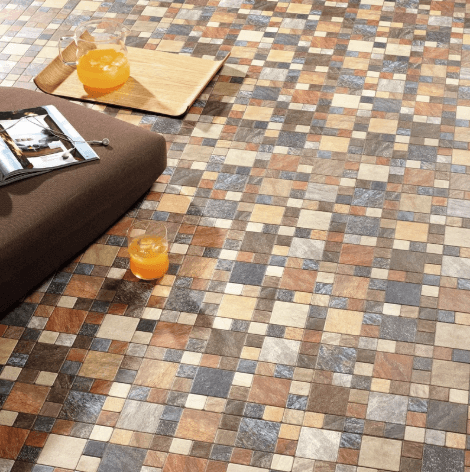 An image of a mosaic tiled floor in various colours.