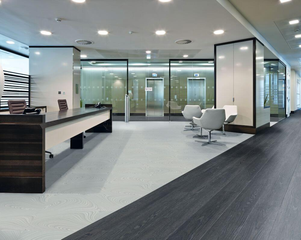 An image of a modern office space with a tiled floor.