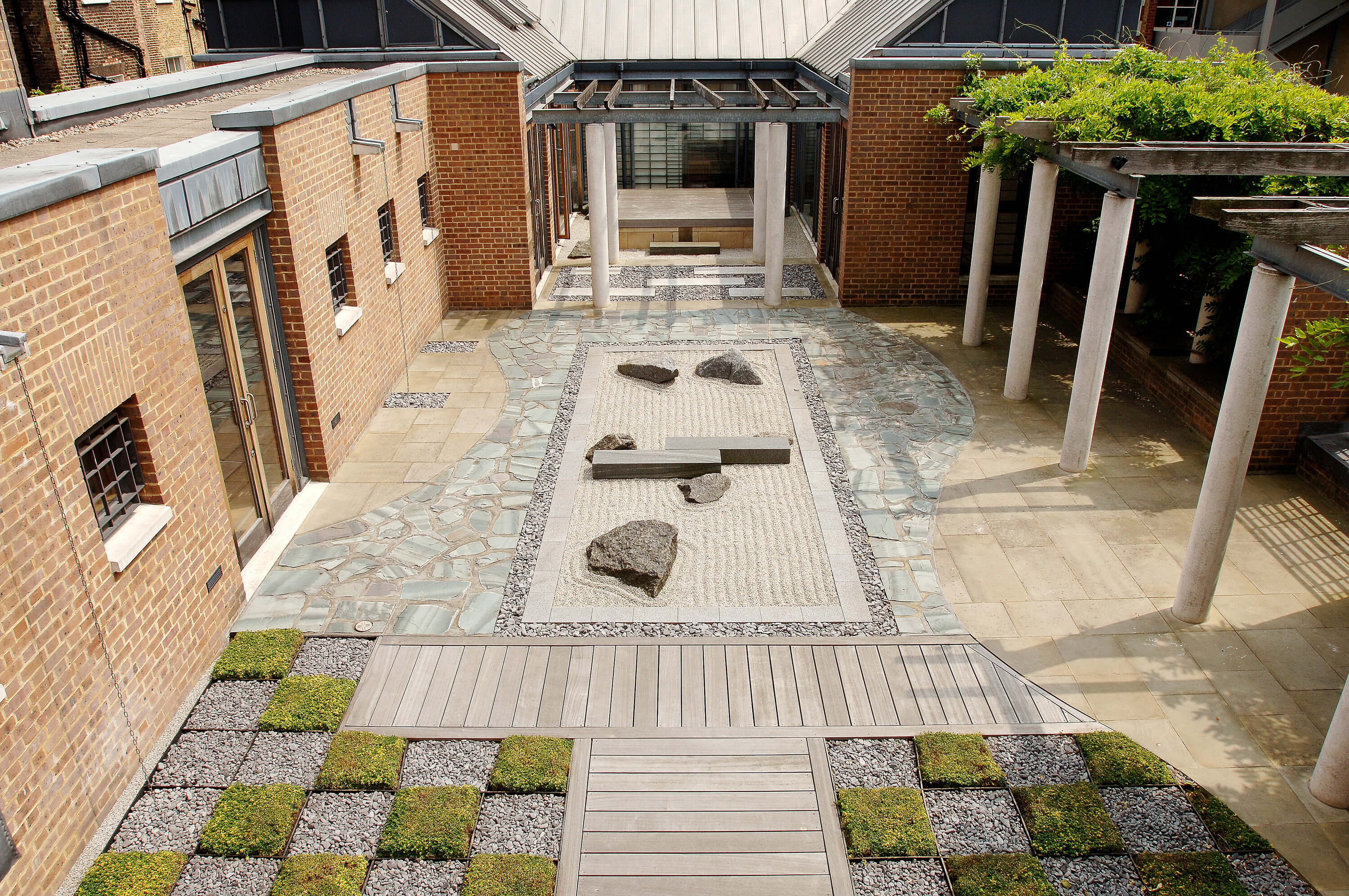 An image of a newly landscaped garden, with fresh tiles laid on the floor.