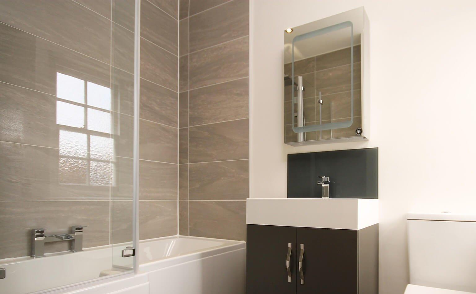 A modern, minimalist bathroom with beige tiles